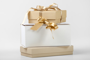 Three gift boxes with golden ribbon