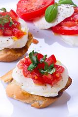 Fresh and tasty bruschetta on white plate
