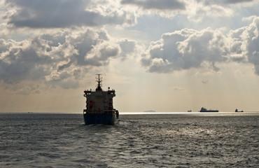 Cargo ship sails away