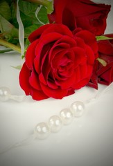 Rose and pearls. Traditional beauty composition