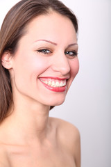 Beautiful woman's face with clean skin and red carmine