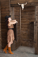 CowGirl standing in saloon entrance