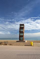 staute on barcelona beach