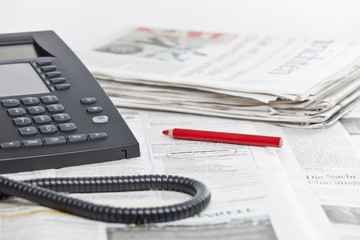Jobsuche in der Zeitung Arbeitsplatz