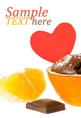 souffle in orange with powder sugar and chocolate and heart mess