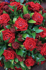 Red roses in a floral arrangement