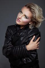 Beauty rock woman in a black leather jacket