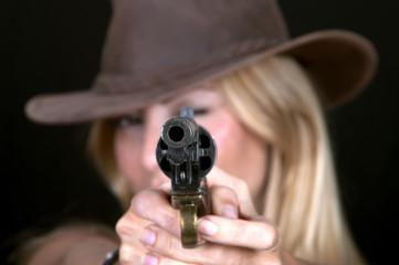 Beautiful cowgirl shooting