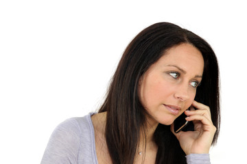 Concerned woman on mobile telephone