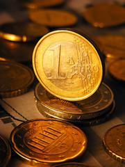 Euro coin on stock chart. Selective focus.
