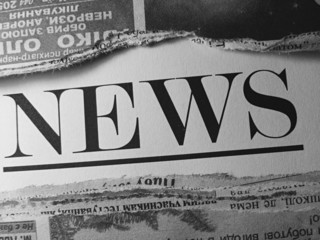 Newspaper in black and white style.