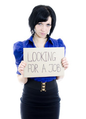 Unemployed woman with cardboard looking for a job.