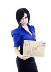 """Unemployed woman with cardboard """"Will work for food""""."""