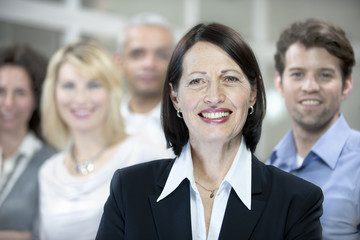 Portrait of a mature businesswoman and business team