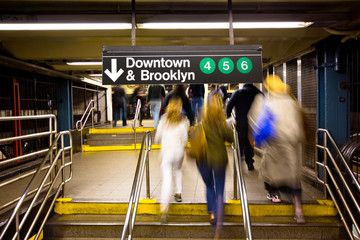 Commuters in NYC Subway Station Rushing