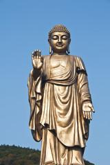 Oriental Buddha Statue, against Peaceful sky