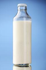 bottle of milk on blue background