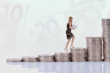 Businesswoman climbing money stairs