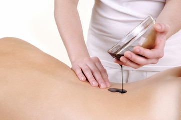 woman receiving chocolate massage over white