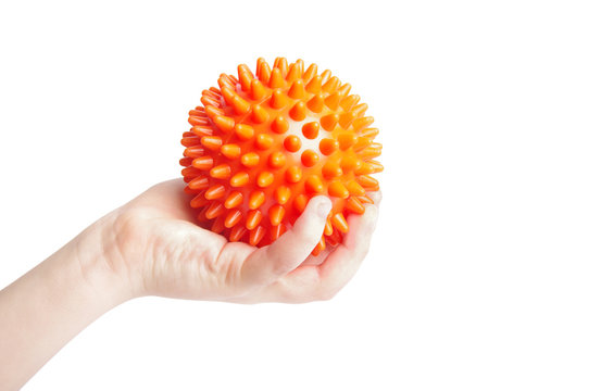 Boy hand with Spiny plastic orange massage ball isolated on whit