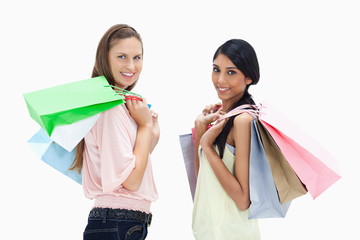 Smiling girls with a lot of shopping bags