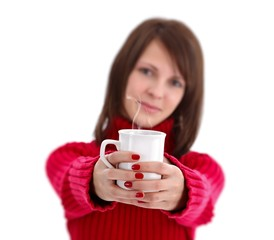 Woman offering a cup of tea