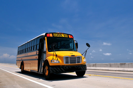 school bus traveling on florida overseas highway from low angle