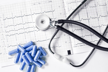 Ekg with stethoscope and pills