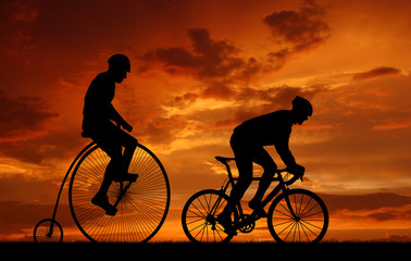 silhouette cyclists on bicycles in the sunset