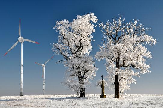 Winter tree with wind turbine