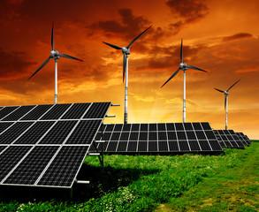 Solar panels and wind turbine in the setting sun