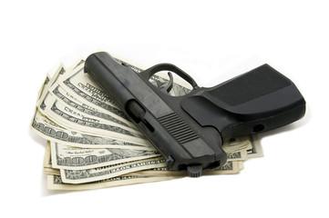 доллары и пистолет на белом фоне