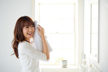 attractive asian woman in the bathroom