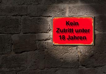 Schild im Rotlicht - Kein Zutritt unter 18 Jahren