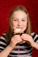 Happy Child eating a cupcake
