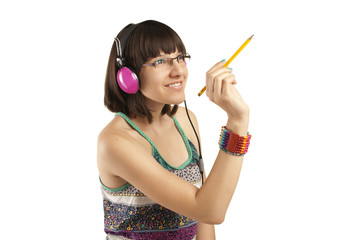 School girl with headphones  writing on a clear screen