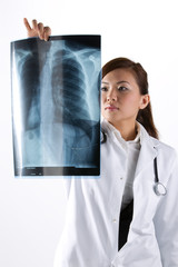 Portrait of a Female Doctor looking at an X-Ray.