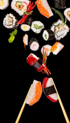 Sushi pices flying on black background