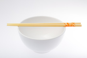 white bowl with chopsticks
