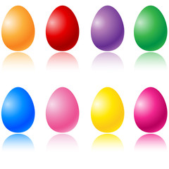 Colored Easter Eggs set on white with reflection.