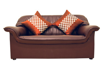 A brown leather sofa with pillows isolated on the white