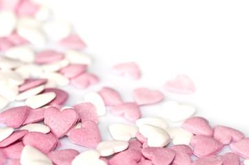 Petits coeurs roses et blancs, fond blanc