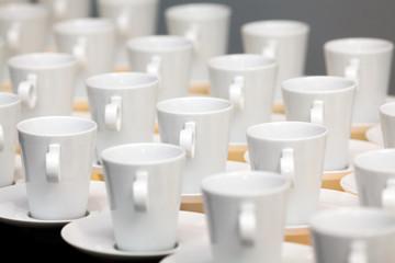 Many white coffee mugs