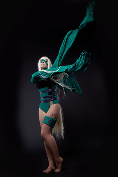 blond girl in green fury cosplay character