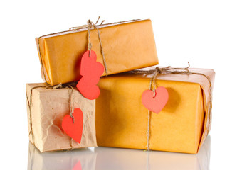 Three parcels with blank heart-shaped labels isolated on white