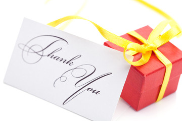 red gift box and thank you card  isolated on white