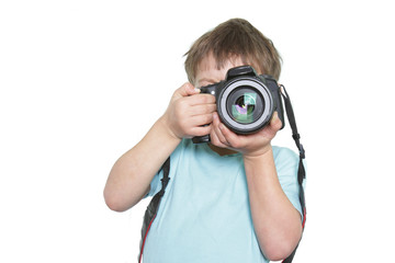 young boy taking picture over white
