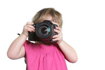 toddler girl with photocamera over white