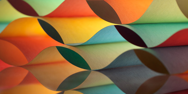 Curved, colorful sheets paper with mirror reflections