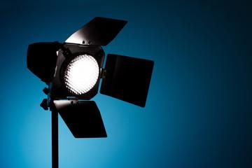 Studio spot light on blue background